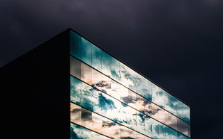 Cloudy sky reflected on glass building 21 s
